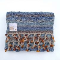 Warm scarf with amber signatures